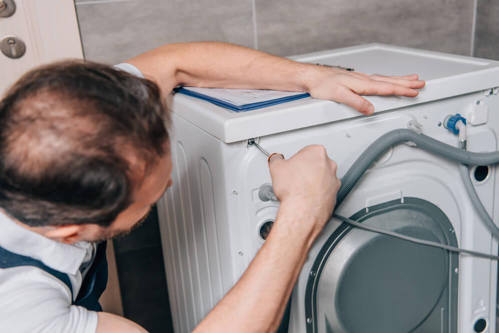 פתיחת סתימה מכונת כביסה